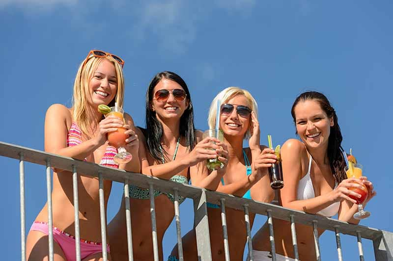 ladies in Miami with drinks that have great recipes